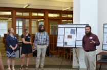 Students from the 2016 field school present drafts of their SEAC posters.