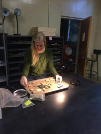 Analyzing ceramics for her MA thesis.