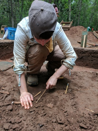Kimi excavating faunal material. Fine tools are used to carefully free the material from the surrounding soils.